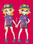 2girls baseball_cap clothes_writing comamawa commentary_request hand_on_hip hat highres holding_hands inkling looking_at_another matching_outfit multiple_girls octoling orange_eyes orange_hair pink_background pointy_ears short_hair short_shorts shorts shorts_under_skirt smile splatoon splatoon_2 standing tentacle_hair
