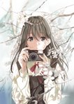 1girl bangs blurry brown_eyes brown_hair camera cherry_blossoms commentary_request day depth_of_field dress flower hair_between_eyes highres holding holding_camera kukiha long_hair long_sleeves looking_at_viewer neck_ribbon original outdoors parted_lips pinafore_dress red_ribbon ribbon school_uniform shirt solo tree_branch upper_body white_shirt wing_collar