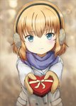 1girl bangs blonde_hair blue_eyes blue_scarf blurry blurry_background blush box casual closed_mouth commentary earmuffs eyebrows_visible_through_hair foreshortening frown gift girls_und_panzer grey_coat heart-shaped_box highres holding holding_gift katyusha long_sleeves looking_at_viewer scarf shibagami short_hair solo standing upper_body valentine yellow_mittens