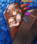 1girl ascot bangs blonde_hair blue_flower blue_rose coffin commentary_request cross crystal eyebrows_visible_through_hair eyelashes flandre_scarlet flower from_above hair_between_eyes hat hat_ribbon holding holding_skull in_container kasuka_(kusuki) looking_at_viewer lying mob_cap on_side one_side_up parted_lips pointy_ears puffy_short_sleeves puffy_sleeves red_eyes red_ribbon red_skirt red_vest ribbon rose shirt short_sleeves skirt skirt_set skull slit_pupils solo touhou vest white_hat white_shirt wing_collar wings yellow_neckwear