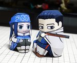 1boy 1girl ainu ainu_clothes asirpa black_hair blue_eyes blurry covered_mouth depth_of_field facial_scar golden_kamuy gun hair_slicked_back hat highres knees_up long_hair military military_uniform muumin_(muumin_craft) ogata_hyakunosuke papercraft photo scar scar_on_cheek short_hair sitting uniform weapon