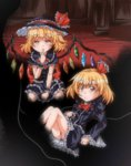 2girls alternate_costume altrouge between_legs blonde_hair darkness finger_to_mouth flandre_scarlet frilled_hat frilled_skirt frilled_sleeves frills gothic_lolita hair_ribbon hand_between_legs hat indoors lolita_fashion multiple_girls pink_eyes ribbon rumia short_hair sitting skirt touhou wings wrist_cuffs
