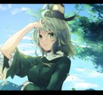 1girl ahoge arm_up bangs blue_sky breasts closed_mouth cloud day expressionless eyebrows_visible_through_hair frilled_sleeves frills green_eyes green_hair hair_between_eyes hat leaf letterboxed long_sleeves looking_at_viewer makuwauri medium_breasts mountain outdoors short_hair sky soga_no_tojiko solo tate_eboshi touhou