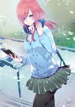1girl bangs blue_cardigan blue_eyes book breasts cardigan closed_mouth day eyebrows_visible_through_hair fingernails go-toubun_no_hanayome grass hair_between_eyes hand_on_headphones headphones headphones_around_neck highres holding holding_book kuso_bba leaf leaves_in_wind long_hair long_sleeves looking_at_viewer medium_breasts nakano_miku outdoors pantyhose pavement pink_hair shirt skirt solo stairs standing thighs white_shirt