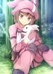 1girl aikawa_tatsuki animal animal_ears animal_hat animal_hug bangs black_footwear blush boots brown_eyes brown_hair bunny bunny_ears bunny_hat cabbie_hat closed_mouth commentary_request cross-laced_footwear day eyebrows_visible_through_hair forest gloves grass hat head_tilt highres jacket lace-up_boots llenn_(sao) long_sleeves looking_at_viewer nature on_grass outdoors pants pink_gloves pink_hat pink_jacket pink_pants sitting smile solo sunlight sword_art_online sword_art_online_alternative:_gun_gale_online tree