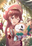 1girl absurdres bangs blurry blurry_background blush brown_eyes brown_hair commentary eyebrows_visible_through_hair gen_7_pokemon hat highres holding holding_pokemon long_hair long_sleeves looking_at_viewer marinesnow one_eye_closed open_mouth outdoors pokemon pokemon_(creature) pokemon_(game) pokemon_sm rowlet smile