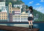 1girl architecture black_hair black_legwear black_skirt building city cloud cloudy_sky commentary_request day from_behind fubuki_(kantai_collection) hand_on_own_face highres house kantai_collection kneehighs medium_hair mountain pier ponytail scenery school_uniform serafuku shirt shoes sidelocks skirt sky solo standing wasabi60 water white_shirt