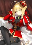 1girl ahoge arm_up black_pants blonde_hair blush braid breasts brooch closed_mouth commentary_request couch crossed_legs crown fate/extella fate/extra fate_(series) green_eyes hair_bun hair_intakes head_tilt jacket jewelry juliet_sleeves kagachi_saku long_sleeves medium_breasts mini_crown nero_claudius_(fate) nero_claudius_(fate)_(all) on_couch pants puffy_sleeves red_jacket sidelocks signature sitting smile solo tilted_headwear