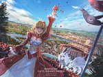 1girl anonamos artist_name blonde_hair blue_sky breasts cleavage cleavage_cutout cloud colosseum dutch_angle fate/grand_order fate_(series) fou_(fate/grand_order) highres juliet_sleeves long_sleeves nero_claudius_(fate) nero_claudius_(fate)_(all) petals puffy_sleeves river rose_petals ruffled_sleeves scenery sky solo