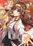 1girl ahoge autumn_leaves bare_shoulders blurry blurry_background blurry_foreground blush breasts brown_hair day depth_of_field detached_sleeves double_bun eyebrows_visible_through_hair hairband headgear highres holding holding_leaf japanese_clothes kantai_collection kongou_(kantai_collection) konkito leaf long_hair looking_at_viewer multiple_girls nontraditional_miko open_mouth outdoors reaching_out remodel_(kantai_collection) skirt smile solo