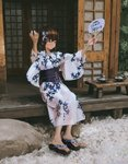 1girl barefoot doorway empty_room feet floral_print hair_between_eyes hands_up highres japanese_clothes leaf long_sleeves looking_to_the_side original outdoors patterned_clothing plant rock short_hair shrine sitting smile solo tifg39 toes translation_request tree wide_sleeves