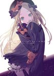 1girl abigail_williams_(fate/grand_order) bangs black_bow black_dress black_hat blonde_hair blue_eyes bow character_name dress empty_eyes fate/grand_order fate_(series) forehead hair_bow hat long_hair looking_at_viewer open_mouth orange_bow parted_bangs polka_dot polka_dot_bow ribbed_dress sleeves_past_fingers sleeves_past_wrists smile solo stuffed_animal stuffed_toy teddy_bear white_background white_bloomers yamakawa