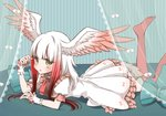 1girl alternate_costume bangs bed bird_tail bird_wings canopy_bed commentary_request dress frilled_dress frills gradient_hair green_eyes head_wings japanese_crested_ibis_(kemono_friends) kemono_friends lying multicolored_hair nail_polish neck_ribbon on_bed on_stomach petit_ramune puffy_short_sleeves puffy_sleeves red_hair red_nails ribbon short_sleeves sidelocks sleeve_cuffs solo thighhighs white_hair wings