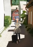 1girl annin_musou barn black_pants blue_eyes blue_hair blurry brown_coat coat commentary_request depth_of_field full_body gotland_(kantai_collection) hair_between_eyes hair_bun highres kantai_collection long_hair looking_at_viewer luggage mole mole_under_eye pants road scenery solo standing waving
