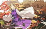 1girl animal_print bangs blonde_hair blurry blurry_foreground breasts closed_mouth commentary_request cowboy_shot depth_of_field eyebrows_visible_through_hair frilled_skirt frills frog_print hair_ribbon hat leaf long_hair long_sleeves looking_at_viewer moriya_suwako outdoors parted_bangs purple_skirt purple_vest red_ribbon ribbon ryokucha_manma shirt skirt skirt_set sleeves_past_fingers sleeves_past_wrists small_breasts smile solo touhou tree turtleneck vest white_shirt wide_sleeves yellow_eyes