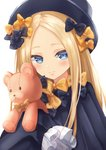 1girl abigail_williams_(fate/grand_order) bangs black_bow black_dress black_hat blonde_hair blue_eyes blush bow closed_mouth commentary_request dress fate/grand_order fate_(series) forehead hair_bow hat ko_31 long_hair long_sleeves looking_at_viewer object_hug orange_bow parted_bangs simple_background sleeves_past_fingers sleeves_past_wrists solo stuffed_animal stuffed_toy teddy_bear very_long_hair white_background