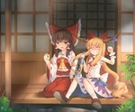 2girls :d arm_up armpits ascot bangs blonde_hair blue_skirt blush bottle bow brown_footwear brown_hair center_frills choko_(cup) clenched_hand commentary cup detached_sleeves drunk eyebrows_visible_through_hair fen_zuo frilled_shirt_collar frills grin hair_bow hair_tie hair_tubes hakurei_reimu holding holding_bottle holding_cup horn_ornament horns house ibuki_suika long_hair long_skirt long_sleeves looking_at_viewer low-tied_long_hair medium_skirt multiple_girls nose_blush on_floor open_mouth orange_eyes outdoors red_bow red_neckwear red_skirt ribbon-trimmed_collar ribbon-trimmed_sleeves ribbon_trim sake_bottle seiza shirt shoes sidelocks sitting skirt sleeveless sleeveless_shirt sliding_doors smile spiked_belt straight_hair teeth tokkuri touhou v-shaped_eyebrows very_long_hair white_shirt wide_sleeves wrist_cuffs yellow_neckwear