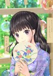 1girl absurdres bangs black_hair blunt_bangs blurry day depth_of_field fan floral_print half_updo head_tilt highres holding holding_fan index_finger_raised japanese_clothes kimono koyoi-kimito long_hair looking_at_viewer obi original outdoors paper_fan ponytail purple_eyes sash shiny shiny_hair smile solo summer sweat uchiwa upper_body wind_chime yukata