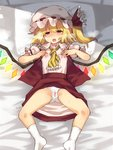 1girl bed blonde_hair blush breast_fondle cameltoe covered_nipples flandre_scarlet hat looking_at_viewer lying masturbation nipple_tweak on_back on_bed open_mouth panties pillow pussy_juice_stain red_eyes red_skirt ribbon saliva see-through shiny shiny_hair short_hair skirt socks solo spread_legs touhou trembling underwear urin wet_spot white_legwear white_panties wings