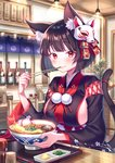 1girl absurdres animal_ear_fluff animal_ears azur_lane bad_id bad_pixiv_id bangs bell black_hair black_kimono blunt_bangs blush bottle bowl breasts cat_ears cat_girl cat_tail ceiling_light closed_mouth commentary eating eyebrows_visible_through_hair food hair_ribbon highres holding_chain indoors japanese_clothes jingle_bell kimono large_breasts long_sleeves looking_at_viewer mask mask_on_head plant pom_pom_(clothes) potted_plant red_eyes red_ribbon restaurant ribbon rope short_hair sideboob sitting smile solo table tail tail_bell tempura tray udon upper_body wide_sleeves wooden_table yamashiro_(azur_lane) zoff_(daria)