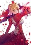 1girl aestus_estus ahoge back bangs blonde_hair blush breasts commentary_request dress eyebrows_visible_through_hair fate_(series) from_side green_eyes hair_intakes hair_ribbon hanato_(seonoaiko) highres holding holding_sword holding_weapon juliet_sleeves large_breasts light_particles long_hair long_sleeves looking_at_viewer nero_claudius_(fate) nero_claudius_(fate)_(all) open_mouth petals puffy_sleeves red_dress ribbon sidelocks simple_background skindentation smile solo sparkle sword weapon white_background