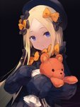 1girl abigail_williams_(fate/grand_order) bangs black_bow black_dress black_hat blonde_hair blue_eyes bow closed_mouth commentary_request dress fate/grand_order fate_(series) forehead hair_bow hat head_tilt long_hair long_sleeves looking_at_viewer object_hug orange_bow parted_bangs polka_dot polka_dot_bow roll_okashi sleeves_past_fingers sleeves_past_wrists solo stuffed_animal stuffed_toy teddy_bear upper_body very_long_hair