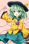 1girl ankle_boots arm_at_side arm_up blouse blush boots brown_footwear cowboy_shot eyebrows_visible_through_hair folded_leg frilled_shirt_collar frilled_sleeves frills green_eyes green_hair green_skirt hair_between_eyes hat hat_ribbon heart heart_of_string highres komeiji_koishi long_sleeves looking_at_viewer open_mouth pink_background ribbon ruu_(tksymkw) shirt short_hair simple_background skirt sleeves_past_wrists solo third_eye touhou untucked_shirt yellow_blouse