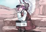 1girl alternate_headwear bangs baseball_cap black_legwear blue_sky blush commentary container day eyebrows_visible_through_hair feathered_wings feet_out_of_frame hand_up hat head_wings ichiba_youichi kneehighs long_sleeves looking_at_viewer mystia_lorelei open_mouth outdoors pink_eyes pink_hair red_skirt red_vest rock shirt short_hair sitting skirt skirt_set sky solo sweat touhou vest white_hat white_shirt white_wings wing_collar wings