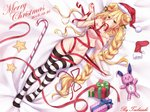 1girl artist_name bed_sheet bell blonde_hair blush bow box breasts christmas cleavage commentary_request date_a_live dated doll double_bun from_above gift gift_box hair_between_eyes hat highres hoshimiya_mukuro large_breasts long_hair looking_at_viewer lying merry_christmas mouth_hold naked_ribbon on_back on_bed red_ribbon ribbon ribbon_in_mouth santa_hat socks solo star striped striped_legwear thighhighs tsubasaki very_long_hair yellow_eyes