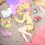 1girl alternate_costume bed blonde_hair book closed_mouth commentary_request computer green_eyes headphones hood hood_down laptop lillie_(pokemon) long_hair long_sleeves lying mifa nintendo_switch on_side open_book pillow pokemon pokemon_(game) pokemon_sm ponytail shorts slippers solo